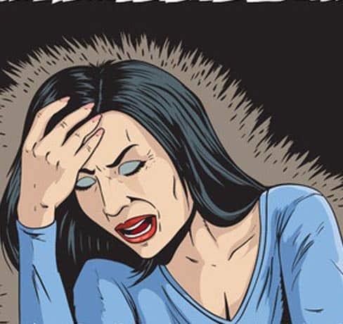 אישה סובלת מכאב ראש